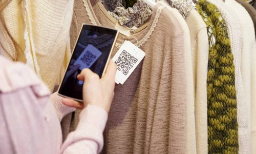Woman,Scanning,A,Qr,Code,,With,Her,Smart,Phone,,From